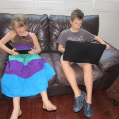both kids on screens