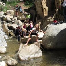 sarah climbing boulders